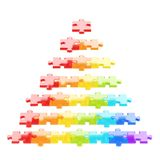 Pyramid made of puzzle pieces isolated. Pyramid made of colorful puzzle pieces isolated over white background Royalty Free Stock Image