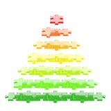 Pyramid made of puzzle pieces isolated. Pyramid made of red, orange, green puzzle pieces isolated over white background Royalty Free Stock Photo