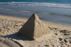 Pyramid made from sand Stock Photos