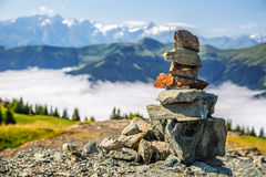 Pyramid made by stones and austrian alps in the backtound. Photo taken on Asitz moutain in Leogang Salzburg.  royalty free stock image