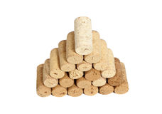 Pyramid made of used Wine corks isolated on white Royalty Free Stock Image