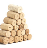 Pyramid made of used Wine corks isolated on white Stock Images
