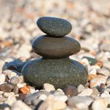 Pyramid made with wet pebble stones Stock Photography
