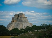 Pyramid of Magician in the old city of Uxmal, Mexico stock images