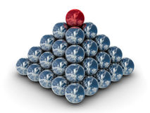 Pyramid from metal spheres on a white background. Stock Image