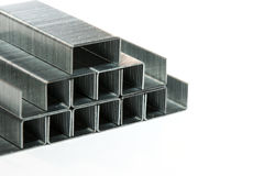 A pyramid of metal staples Royalty Free Stock Images