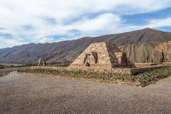 Pyramid Monument to the archaeologists at Pucara de Tilcara old pre-inca ruins - Tilcara, Jujuy, Argentina. Pyramid Monument to the archaeologists at Pucara de stock image