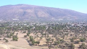 Pyramid of the Moon. Pan movement of Avenue of the Dead and Pyramid of the Moon in Teotihuacan, Mexico stock footage