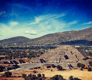 Pyramid of the Moon. Teotihuacan, Mexico. Vintage retro hipster style travel image of famous Mexico landmark tourist attraction - Pyramid of the Moon, view from Stock Images