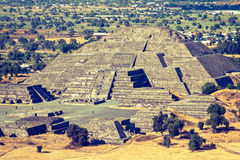 Pyramid of the Moon. Teotihuacan, Mexico. Vintage retro hipster style travel image of Pyramid of the Moon. View from the Pyramid of the Sun. Teotihuacan, Mexico Stock Photos