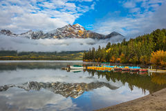 Pyramid Mountain. Boat station with boats waiting for tourists. Pyramid Mountain, Jasper National Park. Concept of active vacation and tourism stock photography