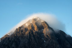 Buachaille etive mor. Pyramid mountain of Scotland in soft morning light Stock Image