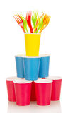 Pyramid from multi-colored disposable cups and plastic forks isolated.. Stock Photos