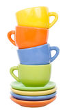 Pyramid from multicolored cups and saucers Royalty Free Stock Images