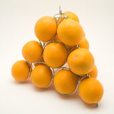 Pyramid of oranges. On a white backgorund stock images