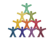 Pyramid of paper cut-out people. Pyramid of colourful paper cut-out people with clipping path Stock Photos
