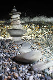 Pyramid from pebble on seacoast at night. Pyramid from pebble on stony seacoast at night Stock Photography