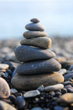 Pyramid of pebble stones Stock Photography