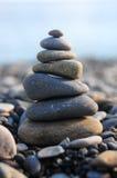 Pyramid of pebble stones Stock Photography