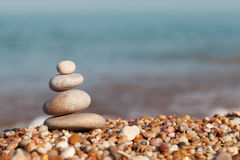 Pyramid of pebbles Stock Images