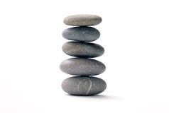 Pyramid from pebbles. Pyramid from the pebbles, represented on a white background Royalty Free Stock Photos