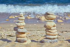 Pyramid of Pebbles. Against of the Sea Royalty Free Stock Image