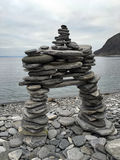 Pyramid of pebbles on the Barents Sea beach in Norway Stock Image