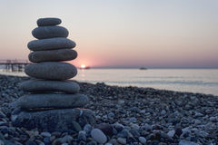 Pyramid of pebbles on the beach Royalty Free Stock Image
