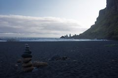 Pyramid of pebbles on black volcanic beach in Iceland Stock Photo