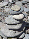 Pyramid of pebbles on a rocky beach Royalty Free Stock Image