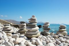 Pyramid of pebbles on a sea beach. Royalty Free Stock Photography