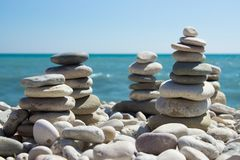 Pyramid of pebbles on a sea beach. Royalty Free Stock Image
