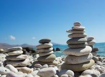 Pyramid of pebbles on a sea beach. Stock Photos
