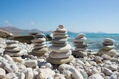 Pyramid of pebbles on a sea beach. Royalty Free Stock Photo