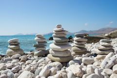 Pyramid of pebbles on a sea beach. Royalty Free Stock Photos