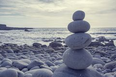 Pyramid of pebbles. On the sea front royalty free stock photos