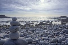 Pyramid of pebbles. On the sea front stock images