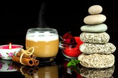 Pyramid of pebbles. Stones on the table. Rest for coffee. Wellness concept. Meditation with a candle. Pyramid of pebbles. Stones on the table. Rest for coffee royalty free stock images