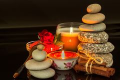 Pyramid of pebbles. Stones on the table. Rest for coffee. Wellness concept. Meditation with a candle. Pyramid of pebbles. Stones on the table. Rest for coffee royalty free stock photo