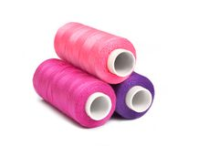 Pyramid of pink, violet and purple bobbins Royalty Free Stock Images
