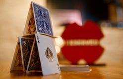 Pyramid of playing cards ace peak lady tambourine