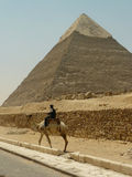 Pyramid and police guard on camel  Stock Photography