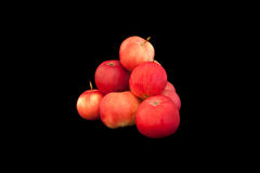 Pyramid of red apples isolated on black. Background Royalty Free Stock Image