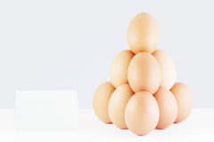 Pyramid of red eggs with a price tag. Pyramid of red eggs with a price tag royalty free stock images