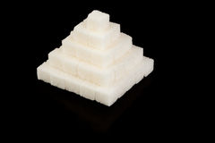 Pyramid from refined sugar. On a black background Stock Image