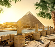 Pyramid and road. Pyramid of Khafre and asphalted road with columns Stock Photography