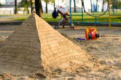 Pyramid of sand. Playground at dusk Stock Image