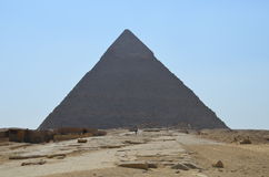 Pyramid in sand dust under gray clouds Royalty Free Stock Photo