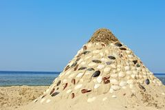 Pyramid of sand and shells Stock Images