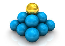 Pyramid Scheme. Pyramid of blue balls and one golden ball Stock Images